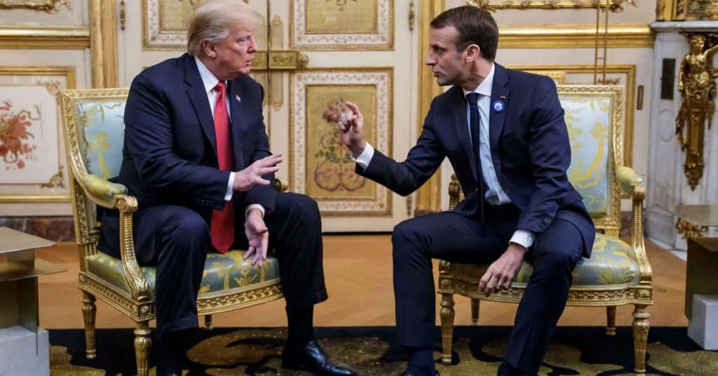 US President Donald Trump (L) speaks s with French president Emmanuel Macron prior to their meeting at the Elysee Palace in Paris, on November 10, 2018.