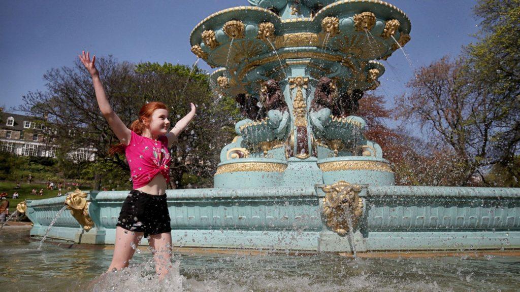 Zoe Beatson, 11, cools off in the Ross Fountain in Edinburgh's Princes Street Gardens
