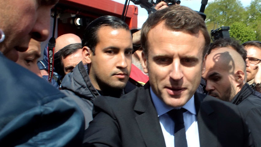 File image of French president Emmanuel Macron, right, flanked by his bodyguard, Alexandre Benalla (AAP)