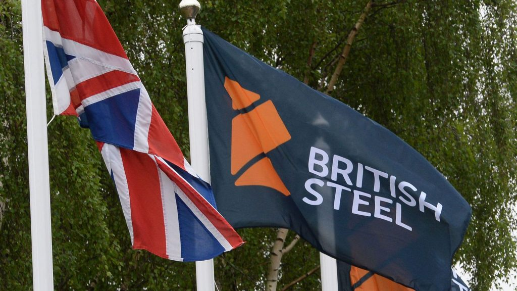 British Steel logo displayed on flags at the entrance to the steelworks plant in Scunthorpe