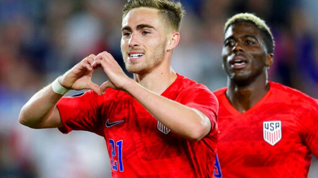 United States' Tyler Boyd, left, celebrates his goal against Guyana with fans as teammate Gyasi Zardes follows during the second half of a CONCACAF Gold Cup soccer match Tuesday, June 18, 2019, in St. Paul, Minn.