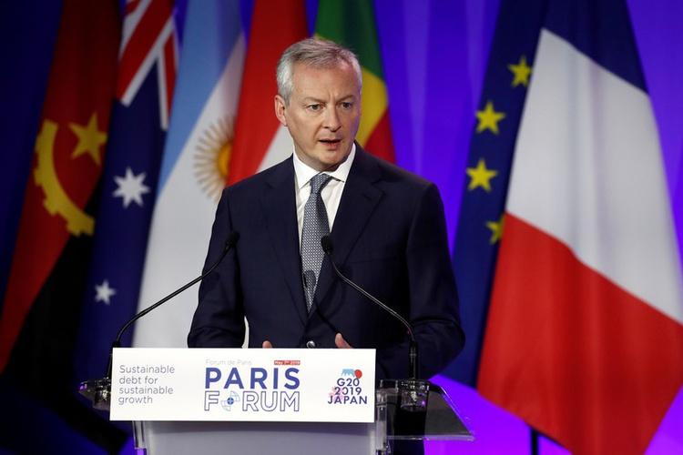 DOSSIER DE PHOTOS: Le ministre français de l'Économie et des Finances, Bruno Le Maire, prononce un discours lors d'un forum de haut niveau sur la dette au ministère des Finances