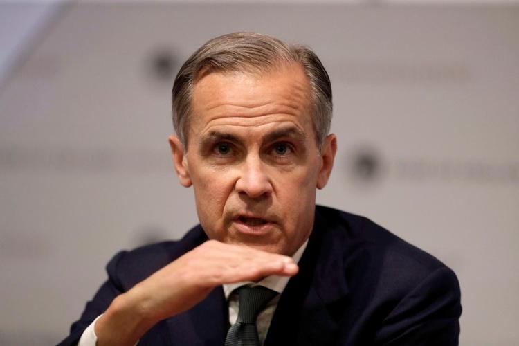 DOSSIER DE PHOTOS: Le gouverneur de la Banque d'Angleterre, Mark Carney, prend la parole lors d'une conférence de presse sur le rapport sur l'inflation à la Banque d'Angleterre, dans la ville de Lo