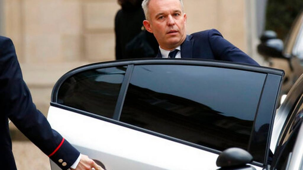 FILE - In this Dec.10, 2018 file photo, French Ecology Minister De Rugy enters his car after a meeting with French President Emmanuel Macron at the Elysee Palace in Paris. Francois de Rugy resigned Tuesday July 16, 2019 over reports of publicly funded lavish lifestyle.